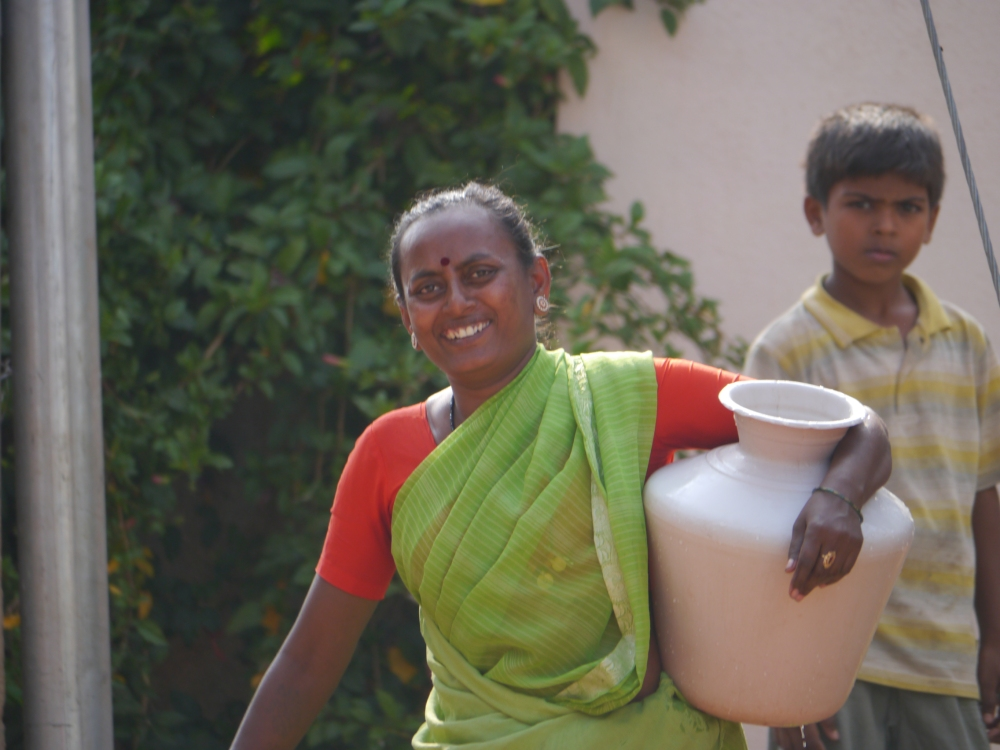 Woman carrying water from Ramagondanahalli