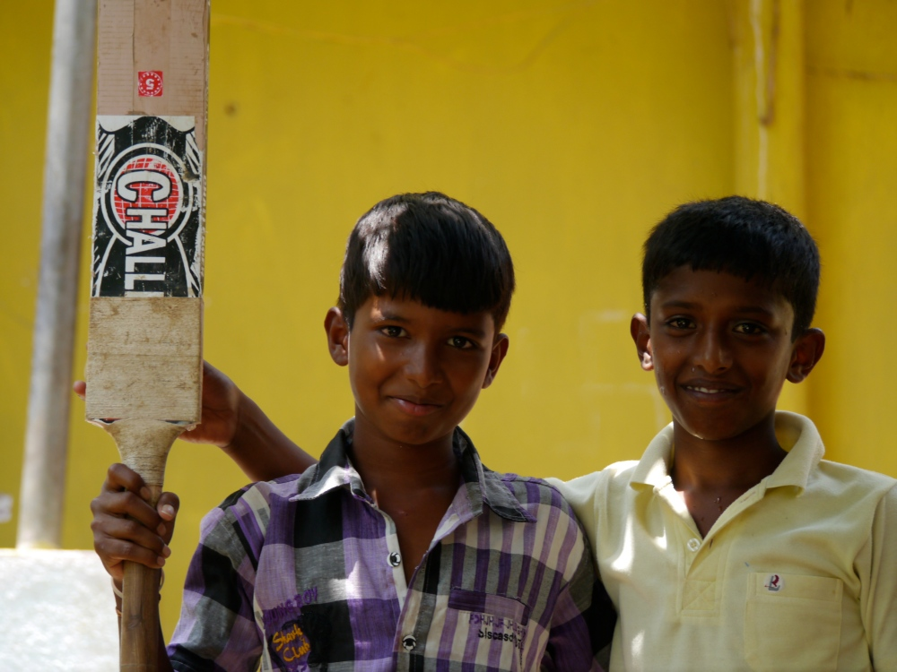 Exide village boys with bat