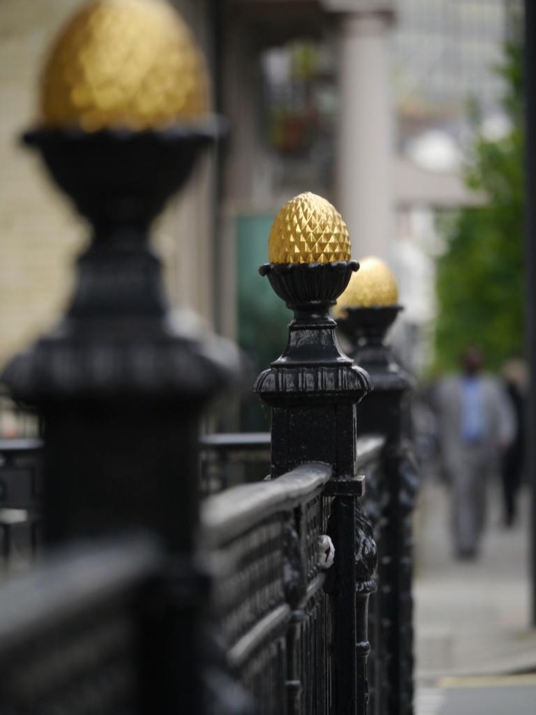 golden balls on railings